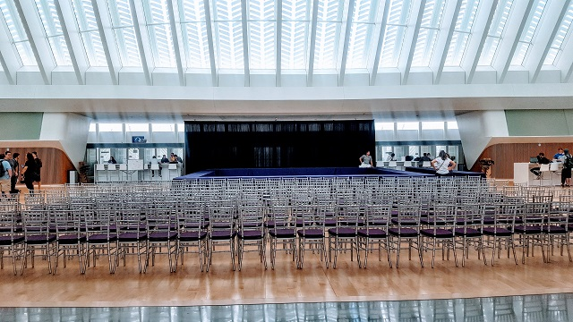SILVER CHIAVARI CHAIRS WITH PIPE AND DRAPE BACK DROP