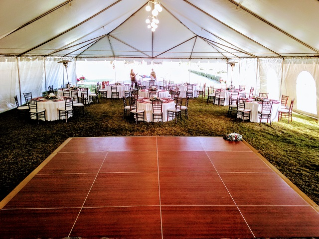WOOD CHIAVARI CHAIRS AROUND OUR 60 INCH ROUND TABLES AND OUR CHERRY WOOD DANCE FLOOR