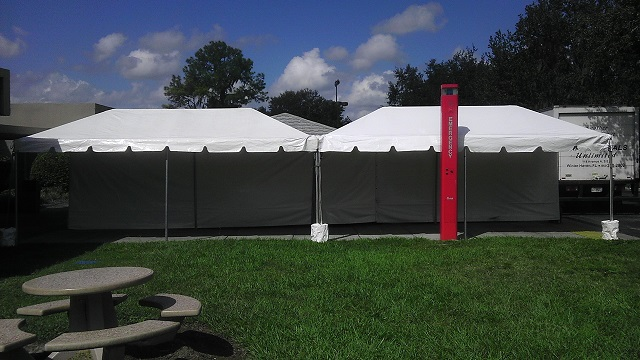 2 10X20 CALIFORNIA FRAME TENTS WITH CONCRETE BUCKETS