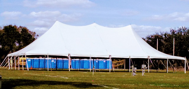 40X80 POLE TENT WITH OUR PORTABLE RESTROOMS BEHIND THE TENT