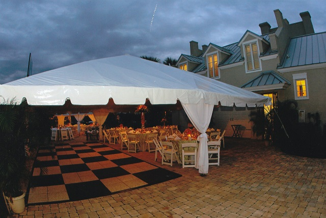 CALIFORNIA FRAME TENTS WITH TABLES, CHAIRS AND OUR CHECKER BOARD DANCE FLOOR