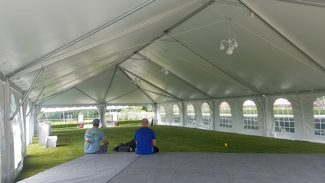 INSIDE OF KEDER FRAME TENT WITH SIDES, LIGHTS  AND CARPETED STAGE