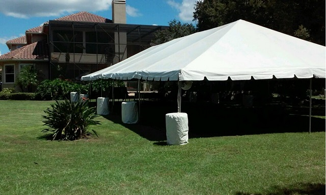 OUR POPULAR CALIFORNIA FRAME TENT WITH FANS AND WATTER BARRELS